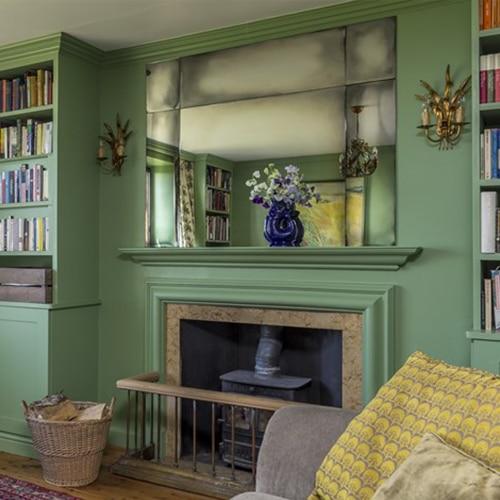 bespoke vintage mirror in a green room